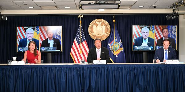 New York Governor Andrew M. Cuomo, joined via video conference with New Jersey Governor Phil...