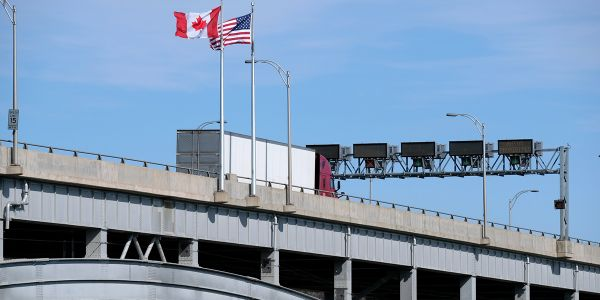 While exempt from 14-day quarantine requirement for truckers entering Canada by road, truckers...