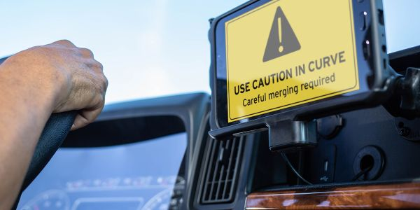When approaching a risk zone, a proactive message flashes on the driver's device to give them a...