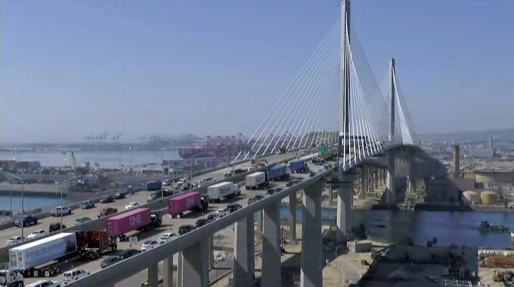 Battery-electric, natural-gas, and fuel-cell electric trucks were featured in a clean trucks parade to celebrate the opening of Port of Long Beach's new cable-stayed bridge - Photo: Screenshot of live-streamed POLB event