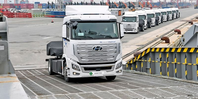 The first 10 Xcient fuel-cell trucks board a ship in Korea bound for Switzerland. They...
