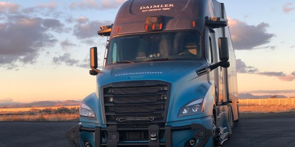 A second-generation Freightliner Cascadia awaits nightfall at the company's Madras, Oregon,...