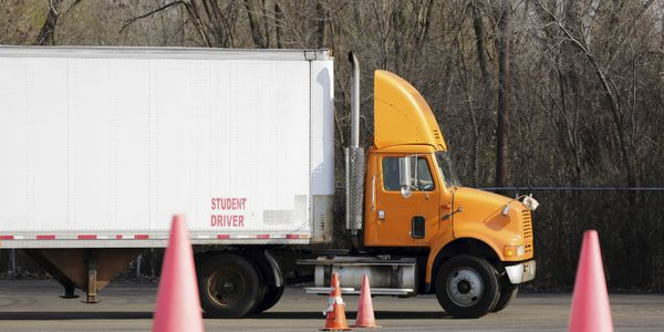 Should the same person who trained a truck driver be allowed to administer the driver's CDL test?