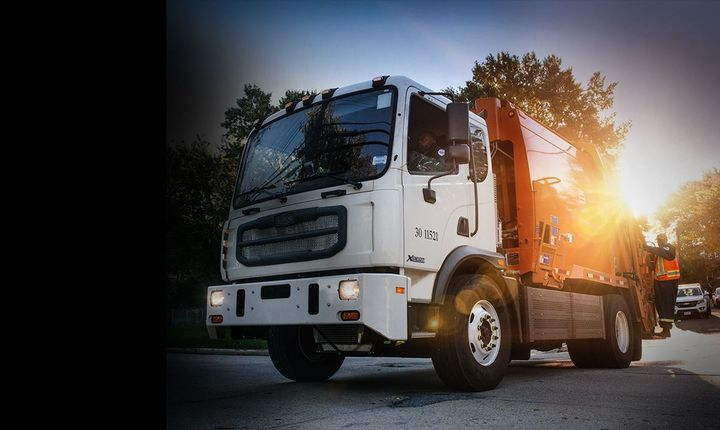 The Autocar ACMD is a Class 7/8 COE suited for refuse, road maintance, and aircraft support. - Photo: Autocar
