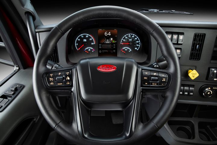 The trucks feature an all-new instrument cluster, featuring an analog speedo and tachometer with a high-resolution, seven-inch digital display which relays key information. - Photo: Peterbilt
