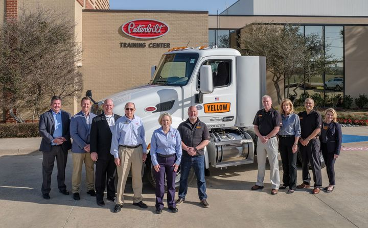 The Yellow team visited Peterbilt's plant in Denton, Texas, where Plant Manager Tina Albert presented driver Greg Dam the keys to his new Model 579. - Photo: Peterbilt