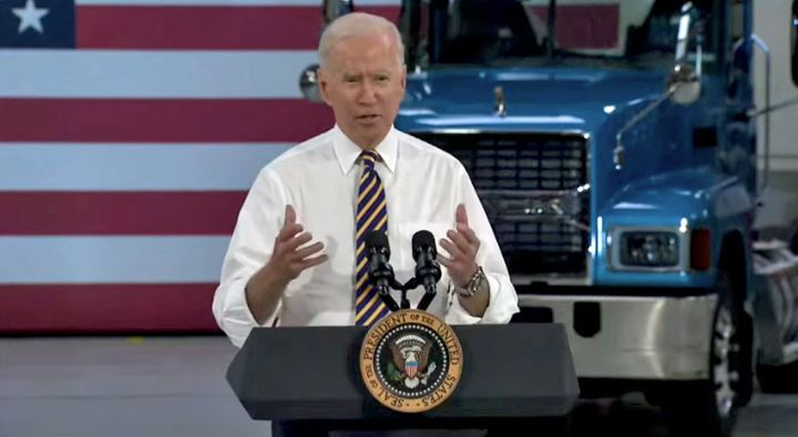 President Biden took off his jacket and rolled up his sleeves as he addressed the audience. - Screenshot: YouTube