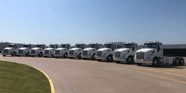 The fully integrated, battery-electric 579EV in operation by Shippers Transport is optimized for...