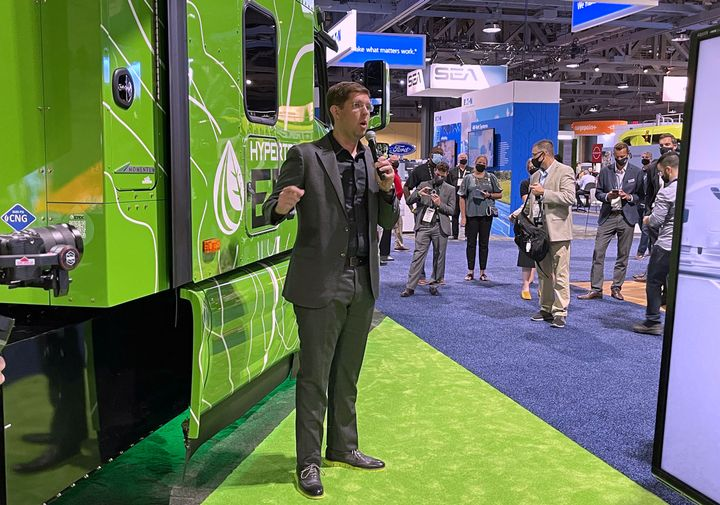 Thomas Healy, founder of Hyliion, speaks at ACT Expo with the new Hypertruck ERX behind him. - Photo: Jack Roberts