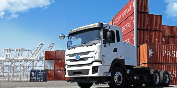 A pilot program uses BYD electric trucks to complete first- and last-mile deliveries to and from...