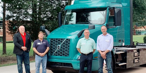 Left to right: Fleetmaster Express COO Travis Smith, CEO Carl Bumgarner, VP of Operations Kevin...