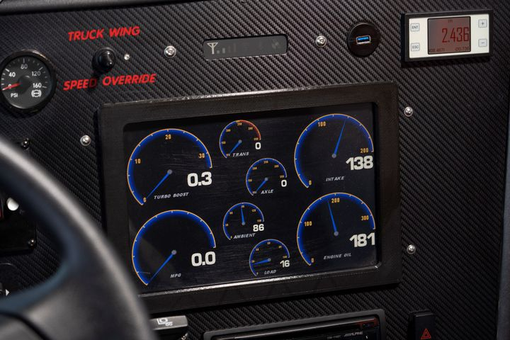 Thedriver's station features a host of display screens, gauges and camera screens. - Photo: Shell