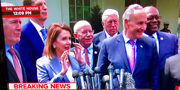 House Speaker Nancy Pelosi and Senate Minority Leader Chuck Schumer tell reporters that their...