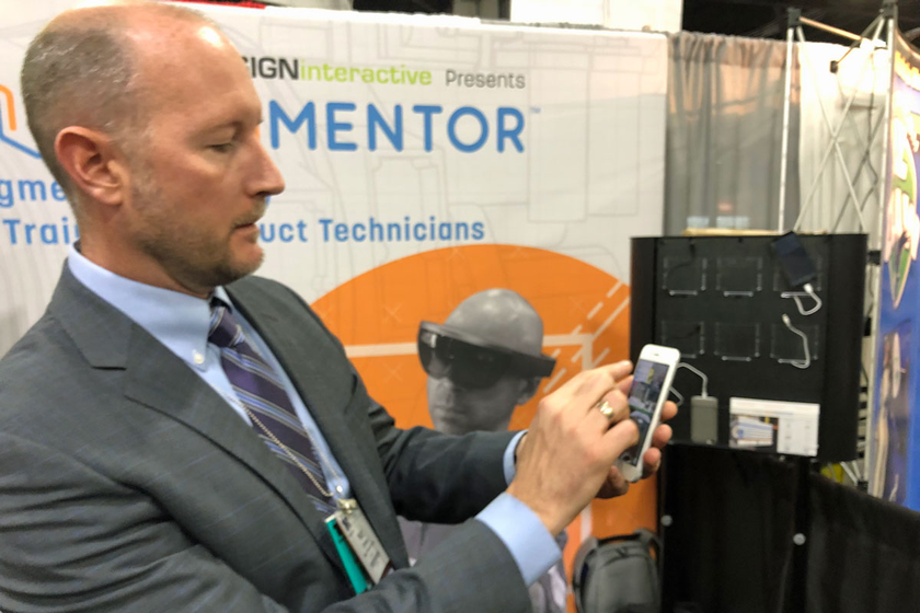 Matt Johnson, division head of commercial solutions, demonstrates the company's augmented...