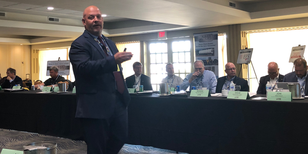 TCA's Dave Heller speaks to the Machinery Haulers Association at its annual meeting in Fontana,...