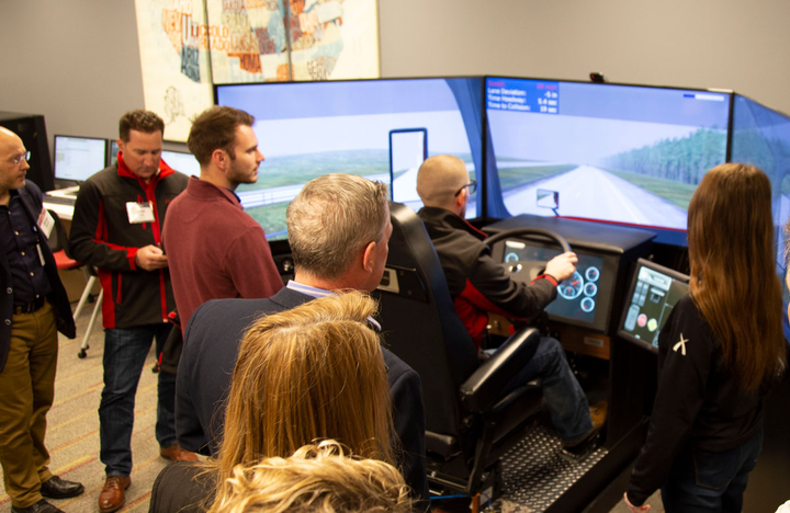 U.S. Xpress demonstrates its driving simulator to members of the media.