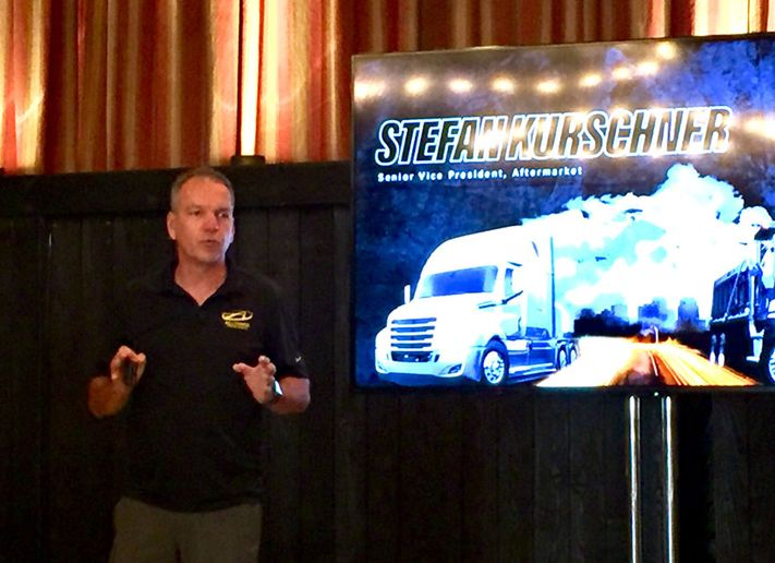 DTNA aftermarket chief Stefan Kurschner explains the company's parts and service initiatives to reporters in California.  - Photo by Deborah Lockridge