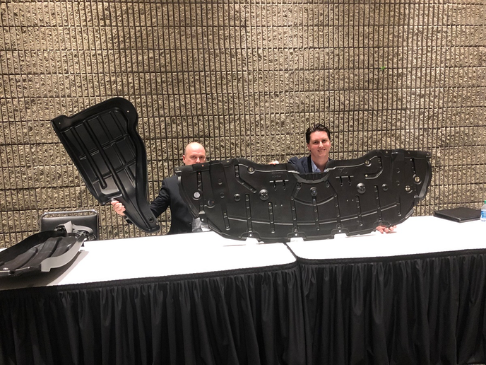 Hadley officials showcase the company's new, lightweight splash guards and plastic barrier components for heavy duty trucks at the TMC annual meeting.