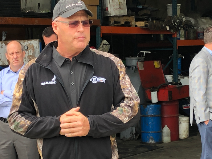 Kevin McCann, vice president of maintenance for Silver Streak Trucking, Maple Valley, talks to journalists about the importance of integrated powertrain technology at the fleet's headquarters in Maple Valley, Washington.