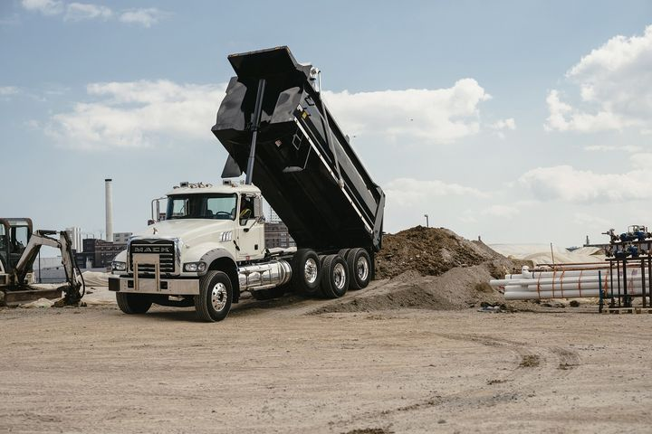 Mack Trucks is making shock absorbers standard on factory-installed auxiliary axles for its Mack Granite models to help reduce tire wear and improve driver comfort.