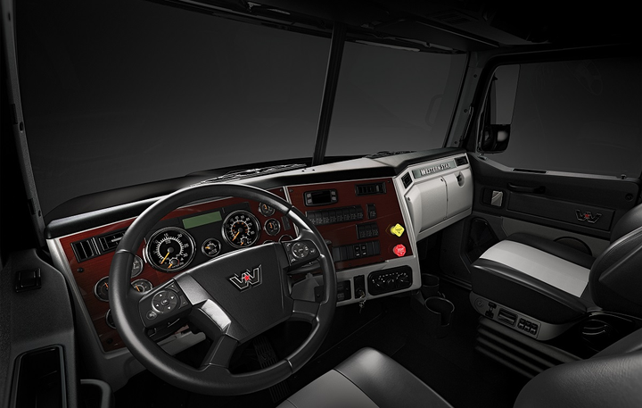 Larger, easier-to-read gauges and additional steering wheel mounted switches are among enhancements in the updated 4700's interior.  -