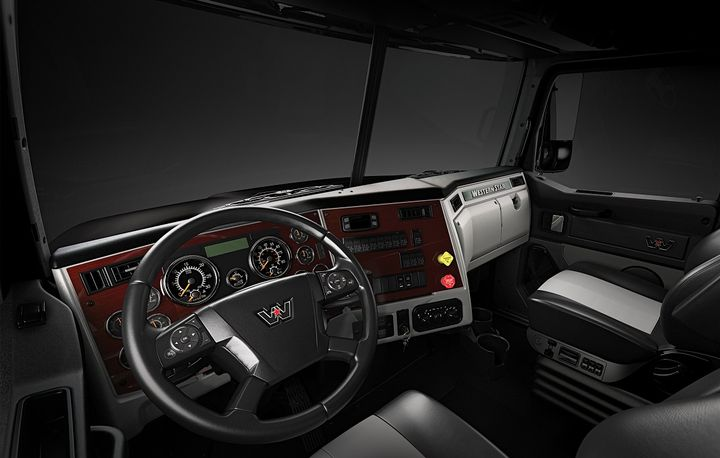 Larger, easier-to-read gauges and additional steering wheel mounted switches are among enhancements in the updated 4700's interior.