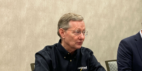 McLeod Software President and CEO Tom McLeod talks to reporters at the company's annual user...