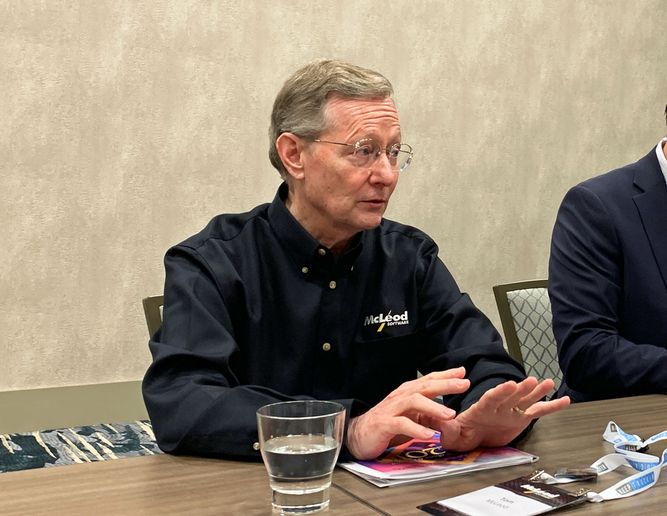 McLeod Software President and CEO Tom McLeod talks to reporters at the company's annual user conference.  - Photo by Deborah Lockridge