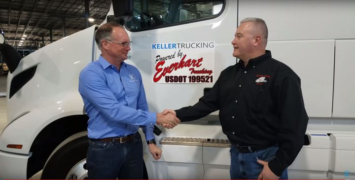Bryan Keller of Keller Trucking and Kent Everhart of Everhart Trucking shake on a deal that brings the combined company to 200 trucks and 550 trailers.