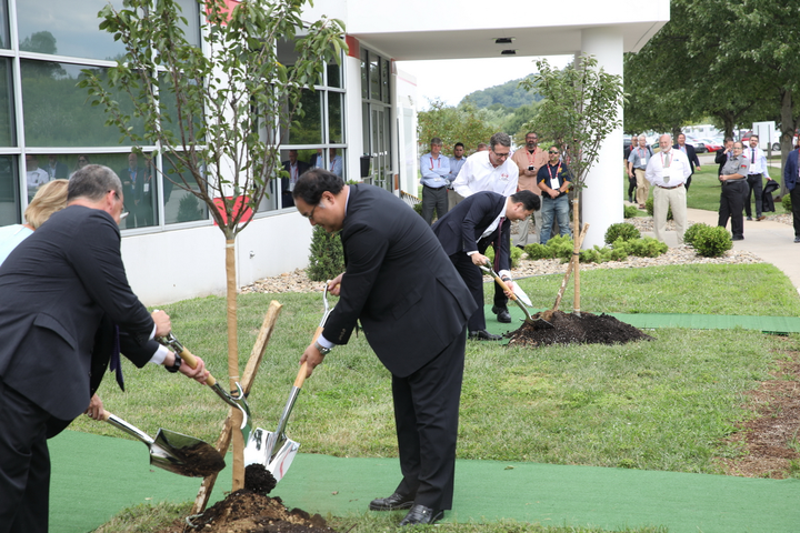 Hino executives and invited dignitaries take part in a tradition Japanese tree planting ceremony