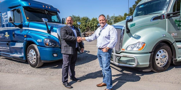 Ron Riddle, CEO of Leavitt's Freight Service (left) joins Rick Williams, CEO of Central Oregon...