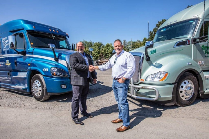 Ron Riddle, CEO of Leavitt's Freight Service (left) joins Rick Williams, CEO of Central Oregon Truck Company (right) as a member of the Daseke family.  - Photo courtesy Daseke