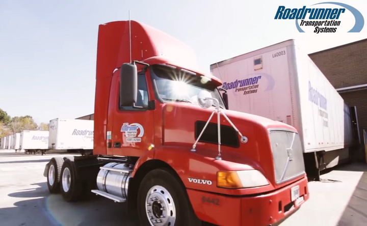 Roadrunner Transportation Systems plans to acquire over 500 sleeper and day cab tractors and acquire or refinance over 2,100 dry and refrigerated trailers.  - Screenshot via Roadrunner Transportation Systems Facebook