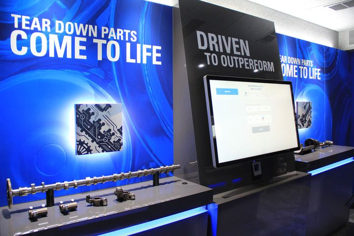 The exhibits in Chevron's rolling lab use technology such as virtual reality and augmented reality to help customers learn about engine oils.