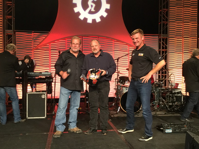 Rusty Rush (left) and Nascardriver Clint Bowyer (right) congratulate Steven Brain, a technician with the Rush Truck Centers Dallas Dealership, on being named the 2018 Rush Technician Rodeo Grand Champion.  - Photo: Jack Roberts