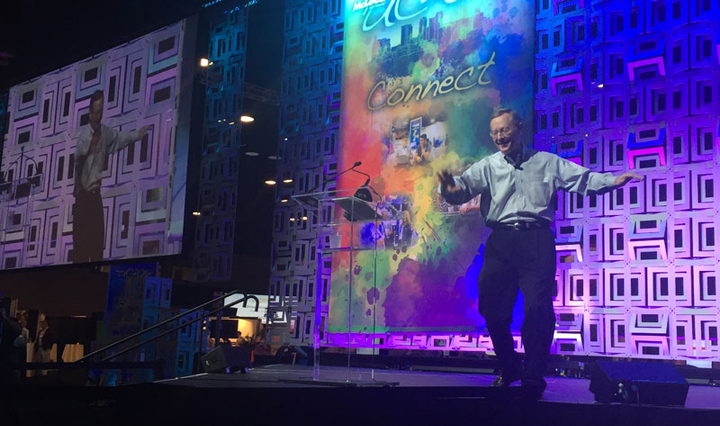 How good is the economy? McLeod Software President Tom McLeod does a little dance before his opening remarks at the company's 2018 user conference.  - Photo by Deborah Lockridge