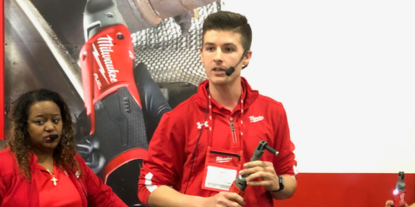 Milwaukee Tools product manager Zach Welsh demonstrates the company's new M12 Extended Reach...