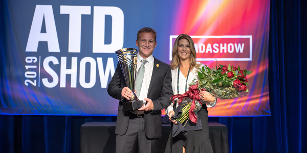 Trey Mytty, joined onstage by his wife Jennifer, was named the Truck Dealer of the Year at the...