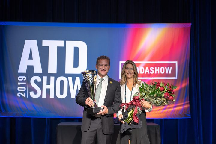 Trey Mytty, joined onstage by his wife Jennifer, was named the Truck Dealer of the Year at this 2019 ATD Show in San Francisco.  - Photo: Dayton Brown