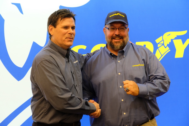 Truck driver Paul Mathias (right) was recognized as a Goodyear Highway Hero for helping a family whose SUV was struck by another vehicle.
