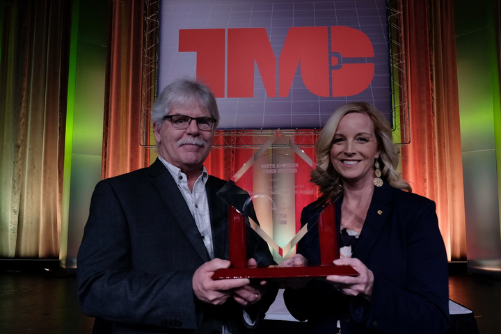 Krista Toenjes, Cummins' North American manager of on-highway sales and marketing, accepts theTechnical Achievement Award from Jim Park, chairman of the truck writers committee and HDT Equipment Editor,during an awards luncheon at the Technology & Maintenance Council's annual meeting in Atlanta.  - Photo courtesy TWNA