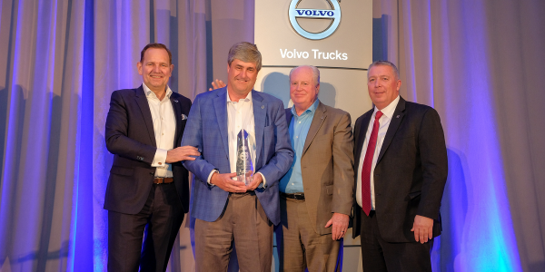 General Truck Sales dealer principal Steve Bassett (left of center) receives the award for the...