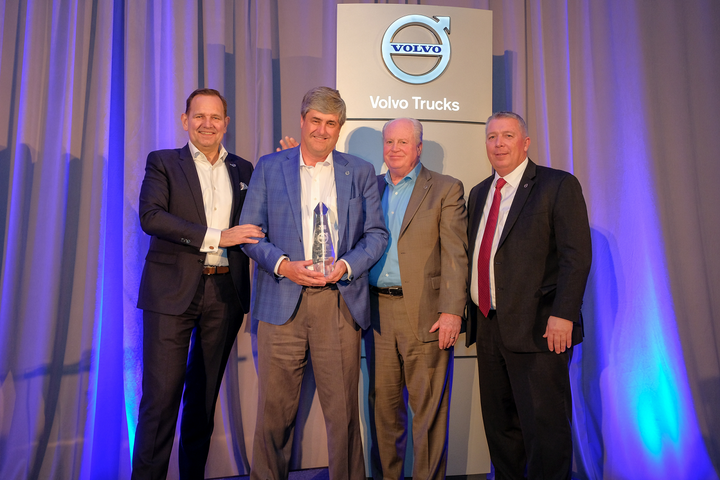 General Truck Sales dealer principal Steve Bassett (left of center) receives the award for the 2018 Volvo Trucks North American Dealer of the Year from (left to right) Peter Voorhoeve, president, Volvo Trucks North America; Bill Hubbartt, regional vice president, central U.S. region; Bruce Kurtt, senior vice president of U.S. sales for Volvo Trucks North America.