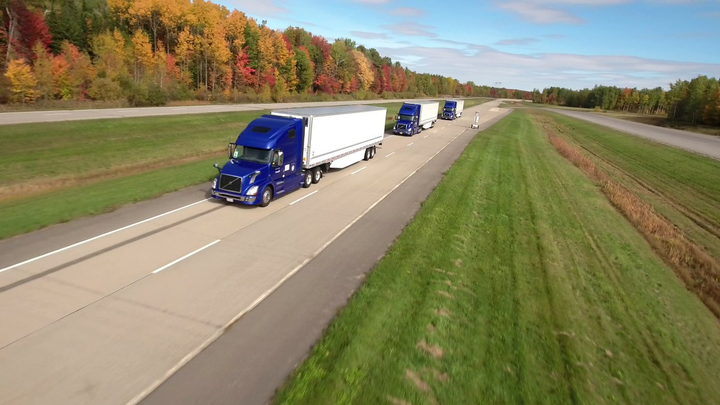 A new report predicts fully autonomous trucks being used in regular operations in little more than a decade. (Above) Test trucks run in a truck platoon on a closed course for evaluation purposes earlier this year.