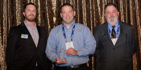 (left to right) Stephane Babcock, managing editor of Heavy Duty Trucking; Michael Lasko; and...