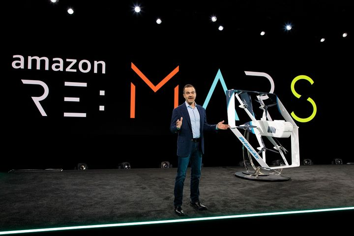 Amazon's latest drone design aims to be capable of delivering packages weighing up to five pounds for distances of 15 miles.