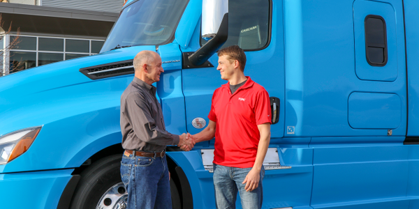 Roger Nielsen, CEO of Daimler Trucks North America (left) andMichael Fleming, CEO of Torc...