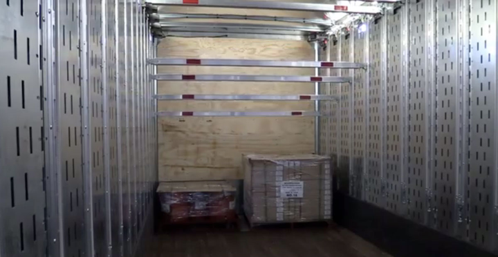 With Ancra's AutoDeck, beams come down at the push of a button to create a deck on which to stack more cargo.  - Screen capture from Ancra video