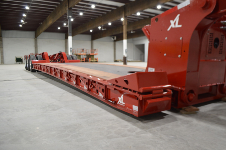 The newly designed Low-Profile Hydraulic Detachable Gooseneck (HDG) offers a loaded deck height of only 15 inches, and with a capacity of 110,000 pounds in 12 feet and many operator-friendly features, the unit is ideal for adaptable hauling in commercial and construction applications.  - Photo: Jim Park