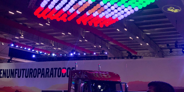 Mexico's flag interpreted in lights appears to float above a VNL tractor in Volvo Trucks North...